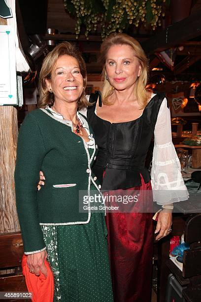 Marie Waldburg and Eva O' Neill attend the 'Almauftrieb' at Kaefer tent during Oktoberfest at Theresienwiese on September 21 2014 in Munich Germany