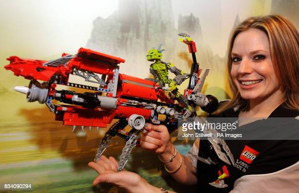 Marie Wardle who works for Lego in the UK holds a Bionicle construction kit which sells for 4999 at the 2008 Toy Fair at ExCel exhibition centre East...