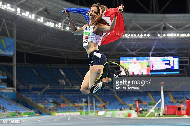 MarieAmelie le Fur of France celebrates winning the gold medal in the Women's 400m T44 Final on day 5 of the Rio 2016 Paralympic Games at the Olympic...