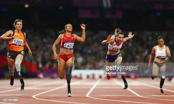 MarieAmelie le Fur of France crosses the line to win gold ahead of April Homes of the United States and Marlou Van Rhijn of Netherlands Women's 100m...