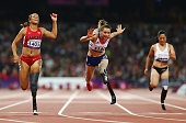 MarieAmelie le Fur of France trips as she crosses line to win gold ahead of April Homes of the United States Women's 100m — T44 Final on day 4 of the...