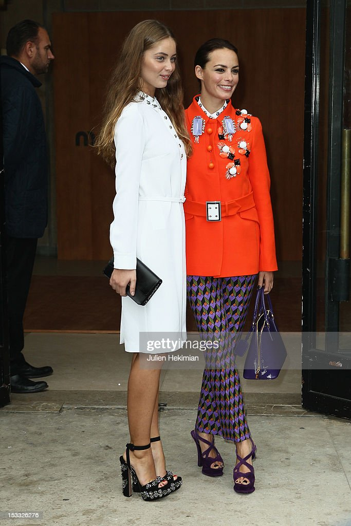 Marie-Ange Casta (L) and Berenice Bejo attend the Miu Miu Spring/Summer 2013 show as part of Paris Fashion Week on October 3, 2012 in Paris, France.