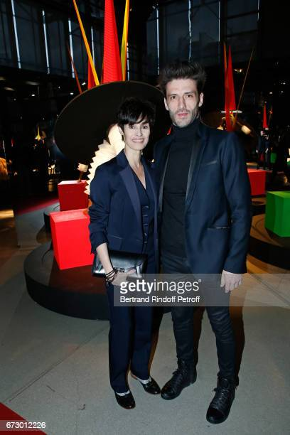 MarieClaude Pietragala and her companion Julien Derouault pose in front the works of JeanPaul Goude during the 'Societe des Amis du Musee d'Art...