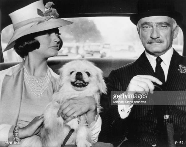 MarieHelene Arnaud and Jean Marais sitting in car with dog in a scene from the film 'Fantomas' 1964