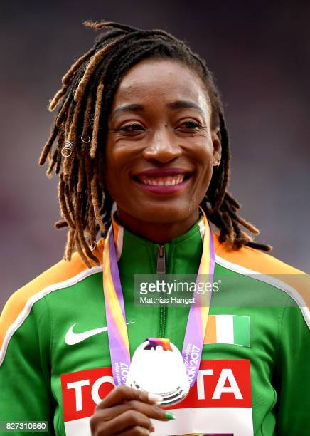 MarieJosee Ta Lou of Cote d'Ivoire silver poses with her medal for the Women's 100 metres during day four of the 16th IAAF World Athletics...