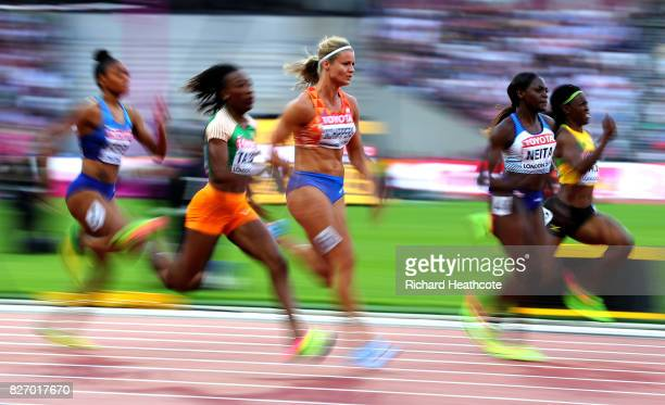 MarieJosee Ta Lou of the Ivory Coast and Dafne Schippers of the Netherlands compete in the women's 100 Metres semi finals during day three of the...