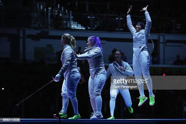 Mariel Zagunis Dagmara Wozniak Monica Aksamit and Ibtihaj Muhammad of the United States celebrate after winning the Women's Sabre Team bronze medal...