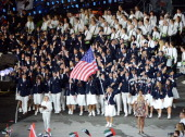Mariel Zagunis of the United States Olympic fencing team carries her country's flag during the Opening Ceremony of the London 2012 Olympic Games at...