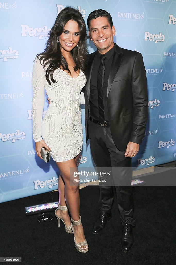 Mariela Encarnacion (L) and her husband arrive at the Estrellas Del Ano De People En Espanol party at The James Royal Palm Hotel on December 12, 2013 in Miami, Florida.