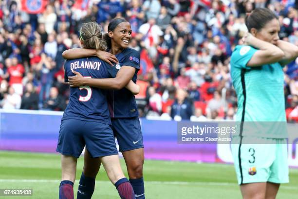 MarieLaure Delie and Sabrina Delannoy of Paris SaintGermain are celebrating the second goal of their team during the Women's Champions League match...