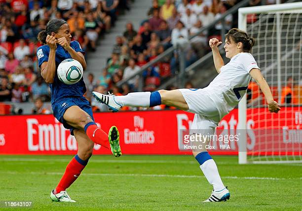 MarieLaure Delie of France challenges Claire Rafferty of England during the FIFA Women's World Cup 2011 Quarter Final match between England and...