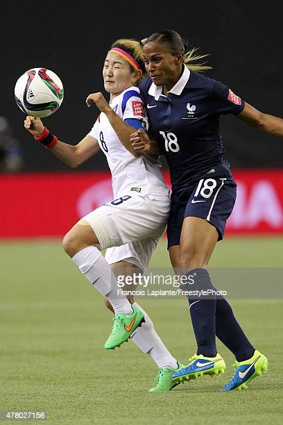 MarieLaure Delie of France challenges Sohyun Cho of Korea during the FIFA Women's World Cup Canada 2015 round of 16 match between France and Korea...
