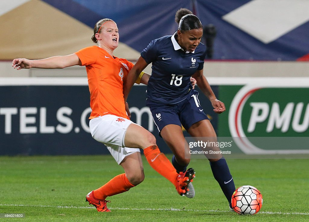 Marie-Laure Delie #18 of France controls the ball against Mandy van den Berg #4 of Netherlands during the international friendly game between France and Netherlands at Stade Jean Bouin on October 23, 2015 in Paris, France.
