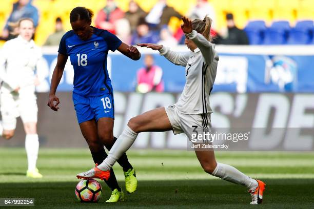 MarieLaure Delie of France drives by Kathrin Hendrich of Germany during their match at Red Bull Arena on March 4 2017 in Harrison New Jersey