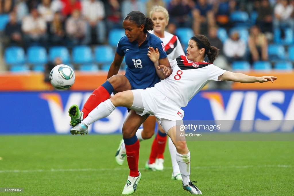 Marie-Laure Delie (back) of France is challenged by Diena Matheson of Canada during the FIFA Women's World Cup 2011 Group A match between Canada and France at the Fifa Womens World Cup Stadium on June 30, 2011 in Bochum, Germany.