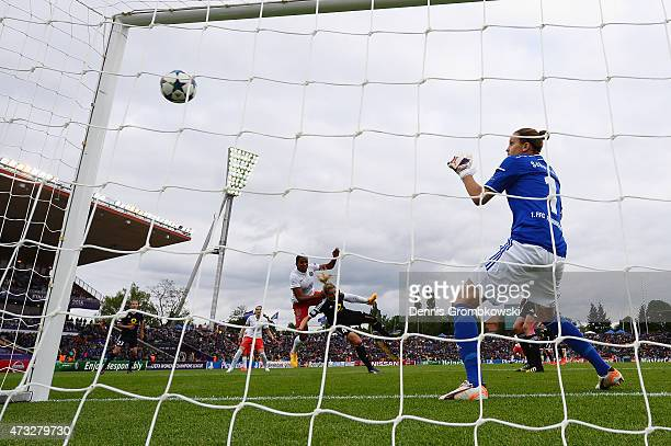 MarieLaure Delie of Paris St Germain heads their first goal past KathrinJulia Hendrich of 1 FFC Frankfurt during the UEFA Women's Champions League...