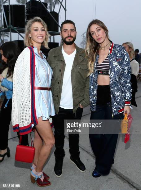 Marielle Hadid Sammy Aflalo and Alana Hadid attend the TommyLand Tommy Hilfiger Spring 2017 Fashion Show on February 8 2017 in Venice California