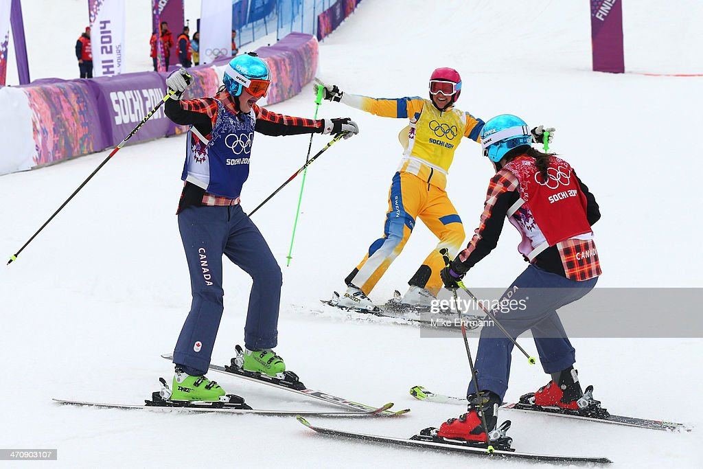 <a gi-track='captionPersonalityLinkClicked' href=/galleries/search?phrase=Marielle+Thompson&family=editorial&specificpeople=7432174 ng-click='$event.stopPropagation()'>Marielle Thompson</a> (L) of Canada celebrates winning the gold medal with silver medalist <a gi-track='captionPersonalityLinkClicked' href=/galleries/search?phrase=Kelsey+Serwa&family=editorial&specificpeople=5653399 ng-click='$event.stopPropagation()'>Kelsey Serwa</a> (R) of Canada watched by <a gi-track='captionPersonalityLinkClicked' href=/galleries/search?phrase=Anna+Holmlund&family=editorial&specificpeople=6652011 ng-click='$event.stopPropagation()'>Anna Holmlund</a> of Sweden in the Freestyle Skiing Womens' Ski Cross Final on day 14 of the 2014 Winter Olympics at Rosa Khutor Extreme Park on February 21, 2014 in Sochi, Russia.
