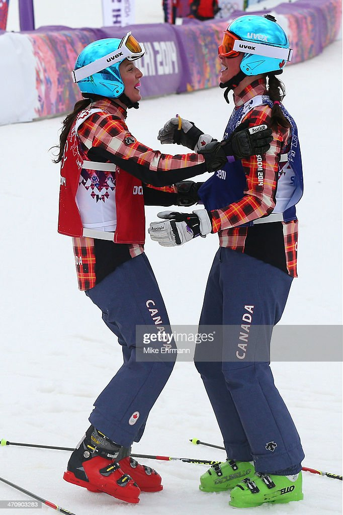 <a gi-track='captionPersonalityLinkClicked' href=/galleries/search?phrase=Marielle+Thompson&family=editorial&specificpeople=7432174 ng-click='$event.stopPropagation()'>Marielle Thompson</a> of Canada celebrates winning the gold medal with silver medalist <a gi-track='captionPersonalityLinkClicked' href=/galleries/search?phrase=Kelsey+Serwa&family=editorial&specificpeople=5653399 ng-click='$event.stopPropagation()'>Kelsey Serwa</a> (L) of Canada in the Freestyle Skiing Womens' Ski Cross Final on day 14 of the 2014 Winter Olympics at Rosa Khutor Extreme Park on February 21, 2014 in Sochi, Russia.