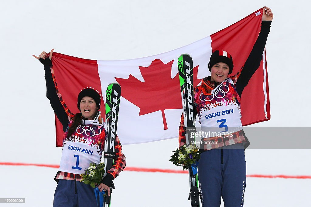 <a gi-track='captionPersonalityLinkClicked' href=/galleries/search?phrase=Marielle+Thompson&family=editorial&specificpeople=7432174 ng-click='$event.stopPropagation()'>Marielle Thompson</a> (R) of Canada celebrates winning the gold medal with silver medalist <a gi-track='captionPersonalityLinkClicked' href=/galleries/search?phrase=Kelsey+Serwa&family=editorial&specificpeople=5653399 ng-click='$event.stopPropagation()'>Kelsey Serwa</a> of Canada during the flower ceremony in the Freestyle Skiing Womens' Ski Cross Final on day 14 of the 2014 Winter Olympics at Rosa Khutor Extreme Park on February 21, 2014 in Sochi, Russia.