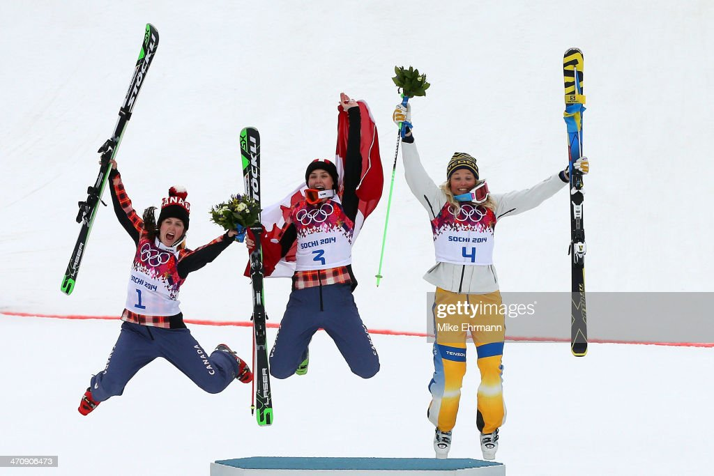 <a gi-track='captionPersonalityLinkClicked' href=/galleries/search?phrase=Marielle+Thompson&family=editorial&specificpeople=7432174 ng-click='$event.stopPropagation()'>Marielle Thompson</a> (C) of Canada celebrates winning the gold medal with silver medalist <a gi-track='captionPersonalityLinkClicked' href=/galleries/search?phrase=Kelsey+Serwa&family=editorial&specificpeople=5653399 ng-click='$event.stopPropagation()'>Kelsey Serwa</a> (L) of Canada and bronze medalist <a gi-track='captionPersonalityLinkClicked' href=/galleries/search?phrase=Anna+Holmlund&family=editorial&specificpeople=6652011 ng-click='$event.stopPropagation()'>Anna Holmlund</a> of Sweden during the flower ceremony in the Freestyle Skiing Womens' Ski Cross Final on day 14 of the 2014 Winter Olympics at Rosa Khutor Extreme Park on February 21, 2014 in Sochi, Russia.