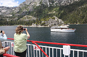Mariellen Yarc the mayor of the Orange County city of Cypress points her smartphone toward a boat passing by Fannette Island in Emerald Bay She is...