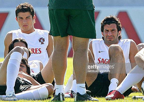 Brazilian head coach of the Portuguese team Luiz Felipe Scolari speaks to his players as he stands in front of captain Luis Figo and forward...