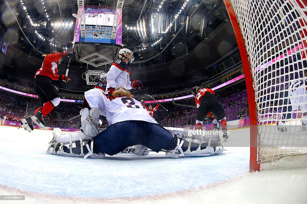 Marie-Philip Poulin #29 of Canada celebrates scoring a third-period goal against Jessie Vetter #31 of the United States during the Ice Hockey Women's Gold Medal Game on day 13 of the Sochi 2014 Winter Olympics at Bolshoy Ice Dome on February 20, 2014 in Sochi, Russia.