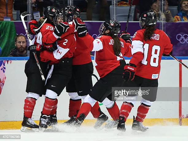 MariePhilip Poulin of Canada celebrates with teammates after her goal in the third period against the United States during the Ice Hockey Women's...