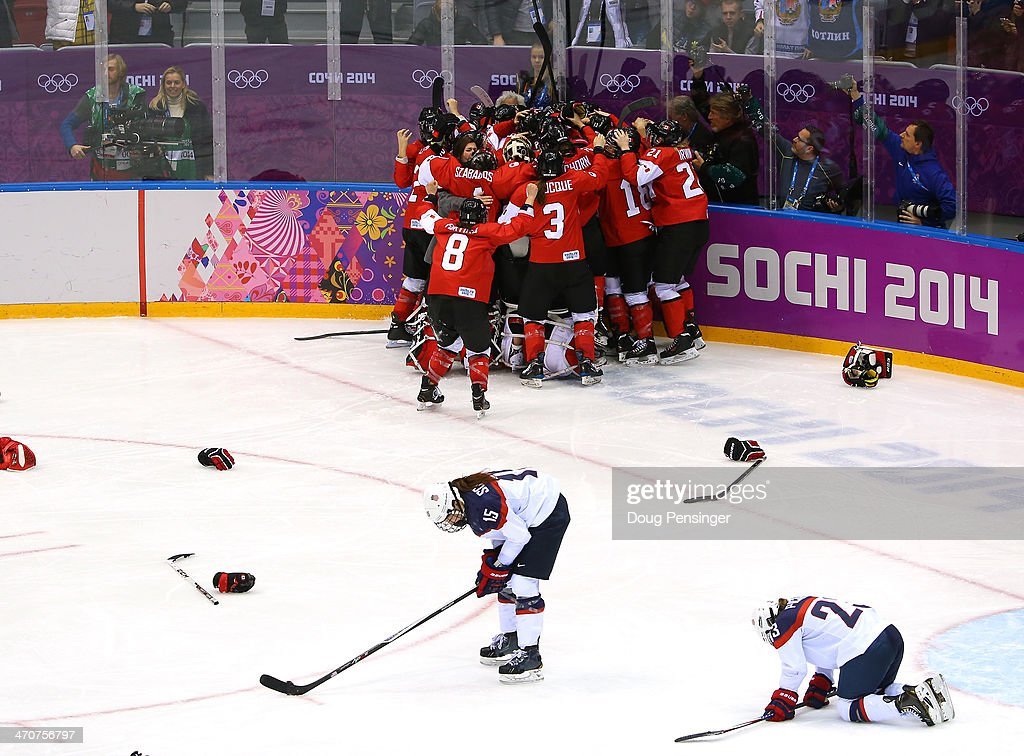 MariePhilip Poulin of Canada celebrates with teammates after scoring the gamewinning goal against the United States in overtime as Anne Schleper and...