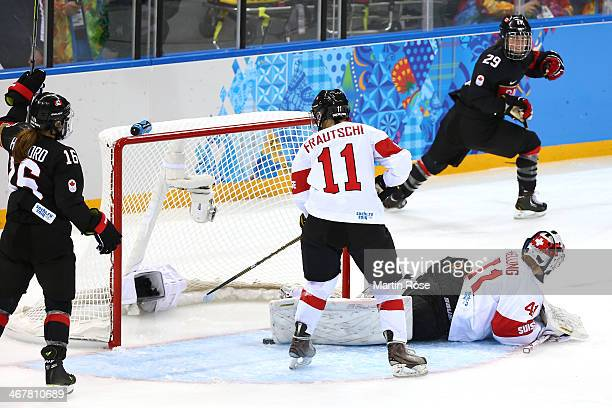 MariePhilip Poulin of Canada scores a goal in the second period against Florence Schelling of Switzerland during the Women's Ice Hockey Preliminary...