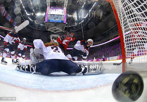 MariePhilip Poulin of Canada shoots and scores a thirdperiod goal against Jessie Vetter of the United States during the Ice Hockey Women's Gold Medal...