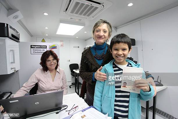MarieReine Dulhoste and her son Camilo Amelian Dulhoste pose in one of Columbia's mobile consulates in Biarritz France on March 16 2013 For the very...
