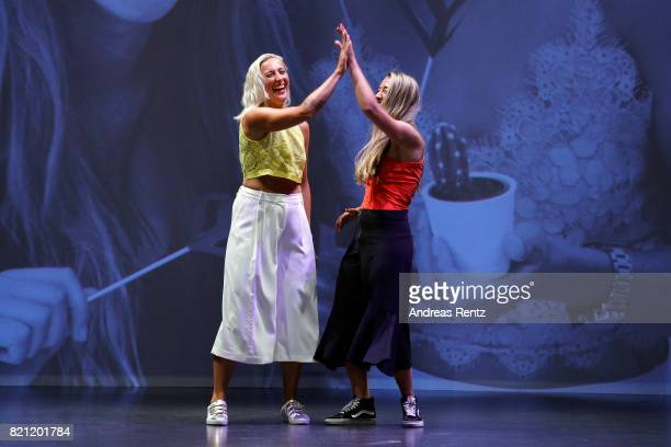 MarieTherese Thiers and Alina Perhoefer acknowledge the aplause of the audience after their show 'WHY' on the runwy at the AMD Exit17_2 show during...