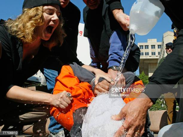 Marietta Hedges yells at volunteer torture victim Maboub Ebrahimzdeh as human rights activists demonstrate water boarding in front of the Justice...