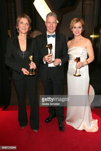 Marietta Slomka Peter Kloeppel and Caren Miosga with award during the Goldene Kamera after show party at Messe Hamburg on March 4 2017 in Hamburg...