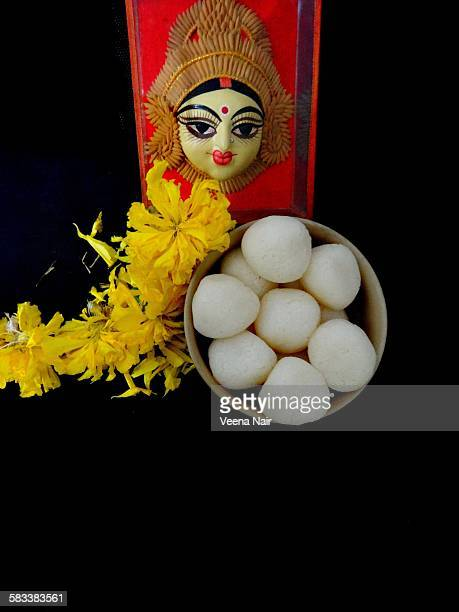 Marigold flowers and rasgulla offered to Goddess