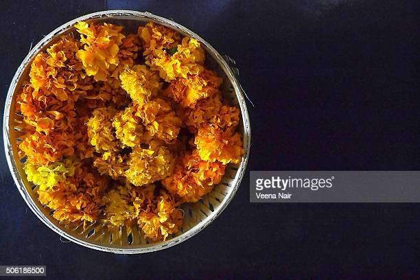 Marigold flowers in a bamboo basket
