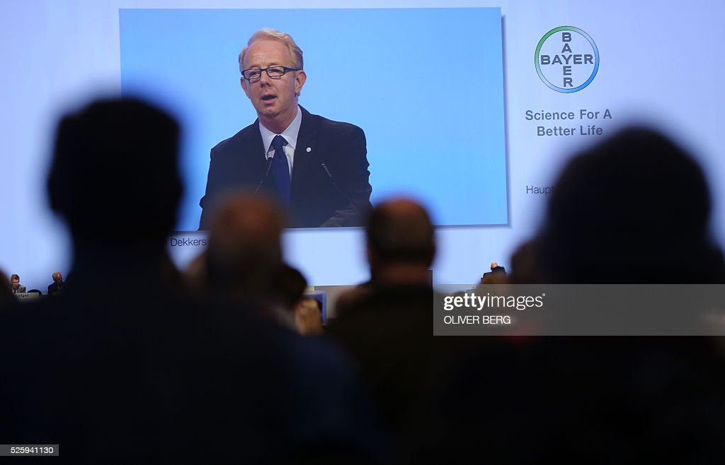 Marijn Dekkers, outgoing CEO of German chemicals and pharmaceuticals giant Bayer, is displayed on a giant screen as he talks to shareholders during his company's annual general meeting on April 29, 2016 in Cologne, western Germany. / AFP / dpa / Oliver Berg / Germany OUT