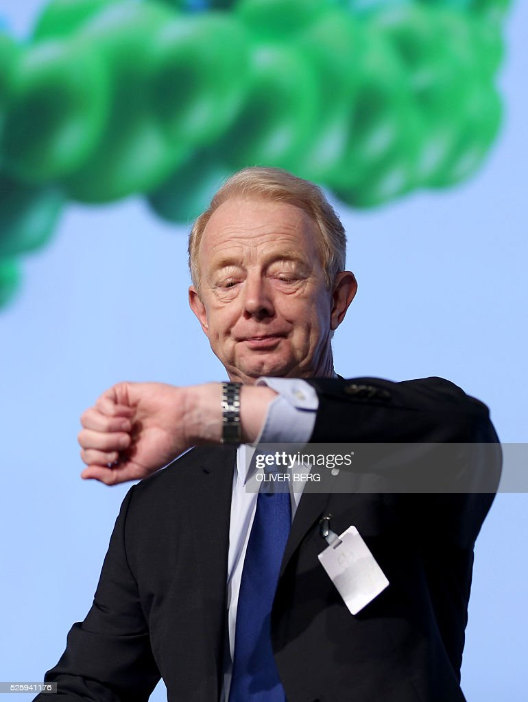 Marijn Dekkers, outgoing CEO of German chemicals and pharmaceuticals giant Bayer, looks at his watch during his company's annual general meeting on April 29, 2016 in Cologne, western Germany. / AFP / dpa / Oliver Berg / Germany OUT