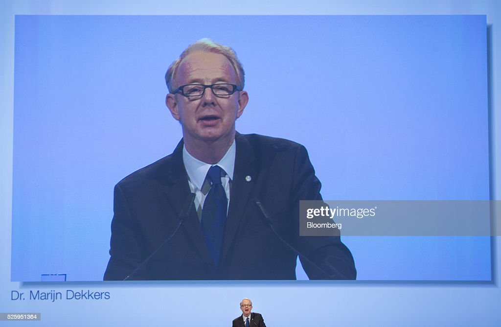 Marijn Dekkers, outgoing chief executive officer of Bayer AG, is displayed on a screen as he speaks during the drugmaker's annual general meeting in Cologne, Germany, on Friday, April 29, 2016. Bayer, Germany's largest company, reported first-quarter profit that beat analysts' estimates as top-selling drugs Xarelto and Eylea continued to soar. Photographer: Jasper Juinen/Bloomberg via Getty Images