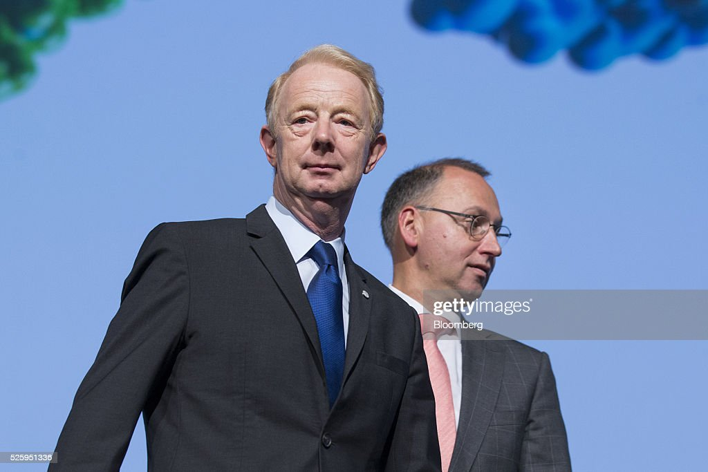Marijn Dekkers, outgoing chief executive officer of Bayer AG, left, and Werner Baumann, incoming chief executive officer of Bayer AG, attend the drugmaker's annual general meeting in Cologne, Germany, on Friday, April 29, 2016. Bayer, Germany's largest company, reported first-quarter profit that beat analysts' estimates as top-selling drugs Xarelto and Eylea continued to soar. Photographer: Martin Leissl/Bloomberg via Getty Images