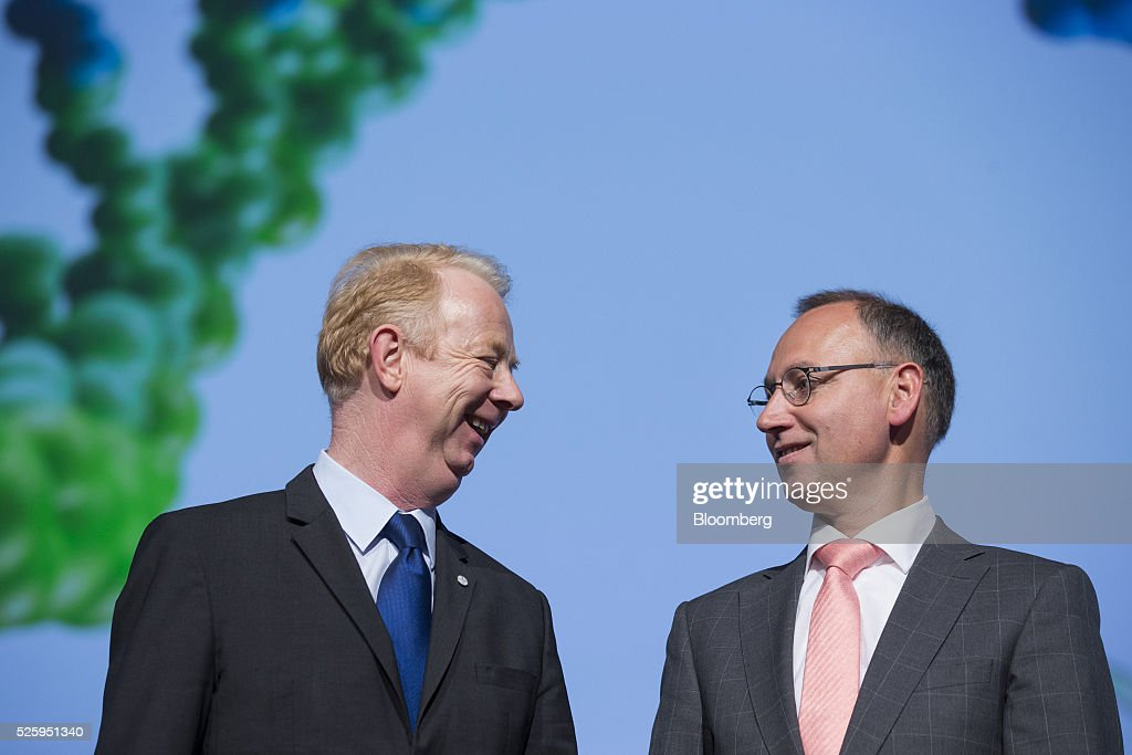 Marijn Dekkers, outgoing chief executive officer of Bayer AG, left, and Werner Baumann, incoming chief executive officer of Bayer AG, pose for a photograph ahead of the drugmaker's annual general meeting in Cologne, Germany, on Friday, April 29, 2016. Bayer, Germany's largest company, reported first-quarter profit that beat analysts' estimates as top-selling drugs Xarelto and Eylea continued to soar. Photographer: Martin Leissl/Bloomberg via Getty Images
