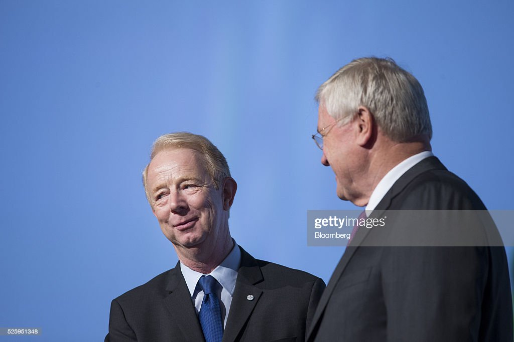 Marijn Dekkers, outgoing chief executive officer of Bayer AG, left, reacts as he stands beside <a gi-track='captionPersonalityLinkClicked' href=/galleries/search?phrase=Werner+Wenning&family=editorial&specificpeople=552600 ng-click='$event.stopPropagation()'>Werner Wenning</a>, chairman of Bayer AG, ahead of the drugmaker's annual general meeting in Cologne, Germany, on Friday, April 29, 2016. Bayer, Germany's largest company, reported first-quarter profit that beat analysts' estimates as top-selling drugs Xarelto and Eylea continued to soar. Photographer: Martin Leissl/Bloomberg via Getty Images
