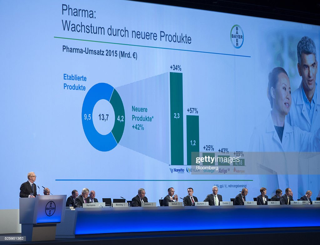 Marijn Dekkers, outgoing chief executive officer of Bayer AG, left, speaks during the drugmaker's annual general meeting in Cologne, Germany, on Friday, April 29, 2016. Bayer, Germany's largest company, reported first-quarter profit that beat analysts' estimates as top-selling drugs Xarelto and Eylea continued to soar. Photographer: Jasper Juinen/Bloomberg via Getty Images