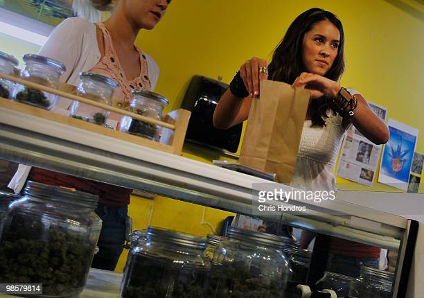 Marijuana saleswoman Marissa Dodd bags up a marijuana sale at the Dr Reefer marijuana dispensary April 20 2010 across from the University of Colorado...