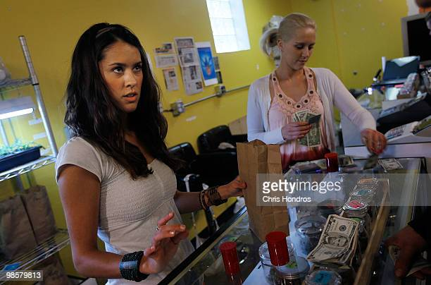 Marijuana saleswoman Marissa Dodd bags up a sale for a customer at Dr Reefer's marijuana dispensary April 20 2010 at the University of Colorado in...