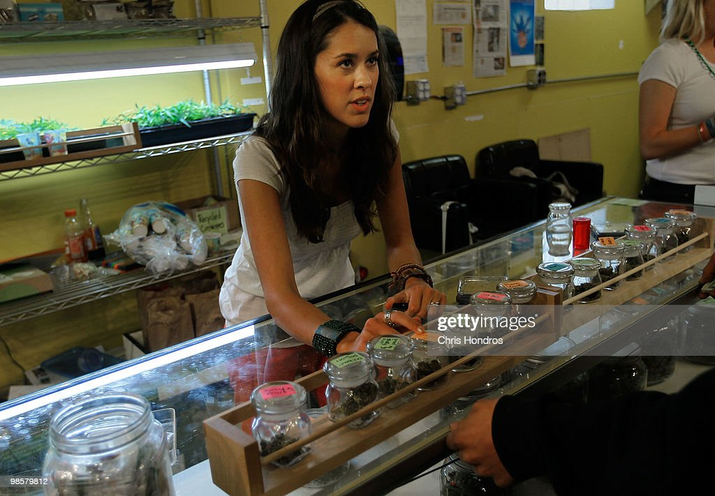 Marijuana saleswoman Marissa Dodd talks to a customer about different varieties of marijuana available at the Dr Reefer marijuana dispensary April 20...