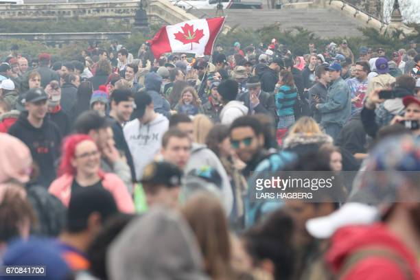 Marijuana smoke lingers around from people smoking weed on Parliament Hill on 4/20 in Ottawa Ontario April 20 2017 Polling released Thursday showed...