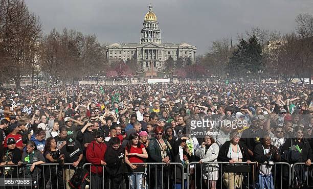 Marijuana smoke rises from a smoking crowd April 20 2010 at a propot '4/20' celebration in front of the state capitol building in Denver Colorado...